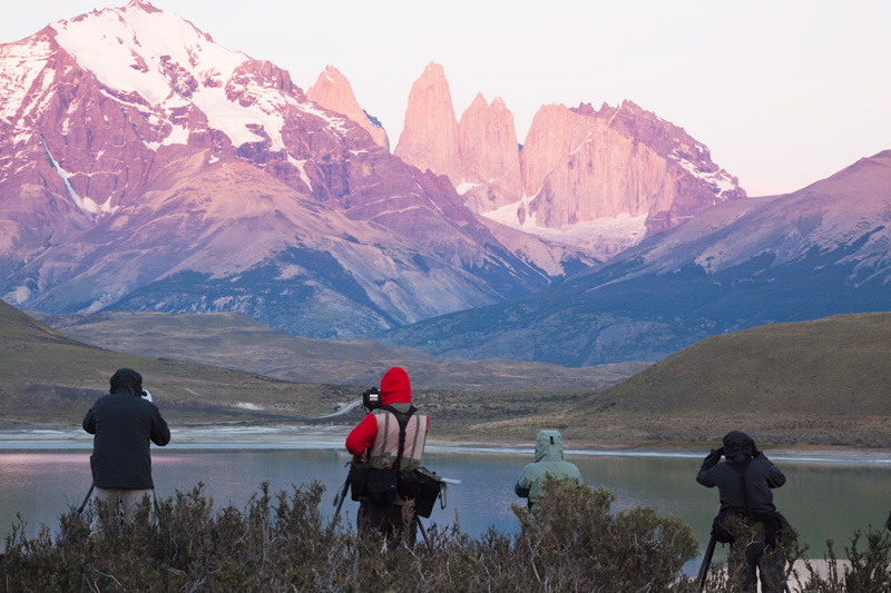Guests 'at location' during sunrise for shooting, Torres del Paine National Park, Chilean Patagonia © Claudio F. Vidal, Far South Expeditions